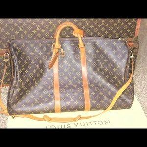 Authentic Louis Vuitton keepall 55 Bandouliere bag